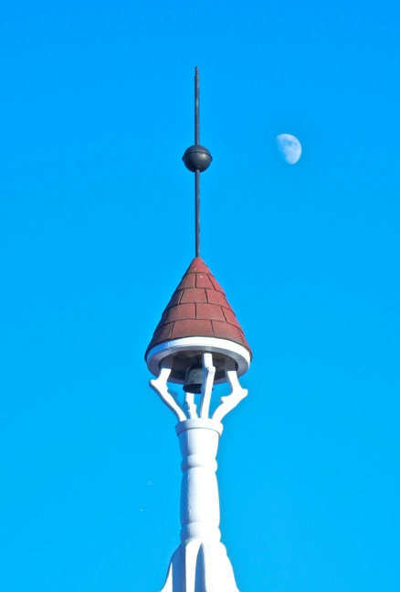 Rooftop spire and half moon