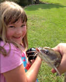 Ava caught her first catfish at the family reunion!